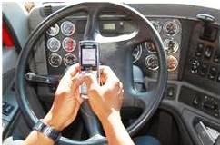 Texting at wheel of car
